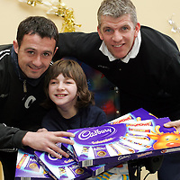 David Hannah and Jim Weir from St Johnstone FC pictured with Demi-Lee Ellis (12) a pupil at the Glebe School, Scone near Perth. Any fines that were imposed on players at St Johnstone by John Connolly and Jim Weir over the last few weeks were to be paid in selection boxes that have been donated to Glebe School and the childrens ward at the Perth Royal Infirmary.<br />