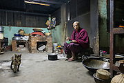 Monk having breakfast with cat, Chauk