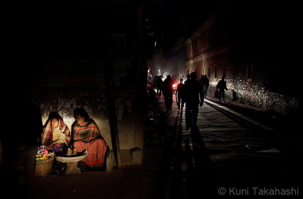(Jan 6, 2012 - Kathmandu, Nepal).Streets are only illuminated by vehicle lights during power outage in Kathmandu, Nepal, on Jan 6, 2012. For the last several years, nearly 800,000 people of the capital city faced up to 16 hours of blackouts every day, mainly caused by political instability. Nepal is said to be second only to Brazil in terms of water resources but the government has been incapable of harnessing hydropower..(Photo by Kuni Takahashi)