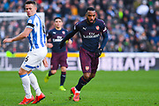 Alexandre Lacazette of Arsenal (9) gets past Jonathan Hogg of Huddersfield Town (6) during the Premier League match between Huddersfield Town and Arsenal at the John Smiths Stadium, Huddersfield, England on 9 February 2019.