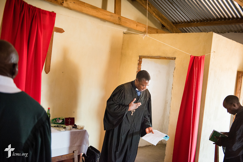 The Rev. Davis Wowa, executive chairman of the Confessional Lutheran Church–Malawi Synod, leads worship in a parish on Saturday, Sept. 26, in Embangweni, Malawi. LCMS Communications/Erik M. Lunsford