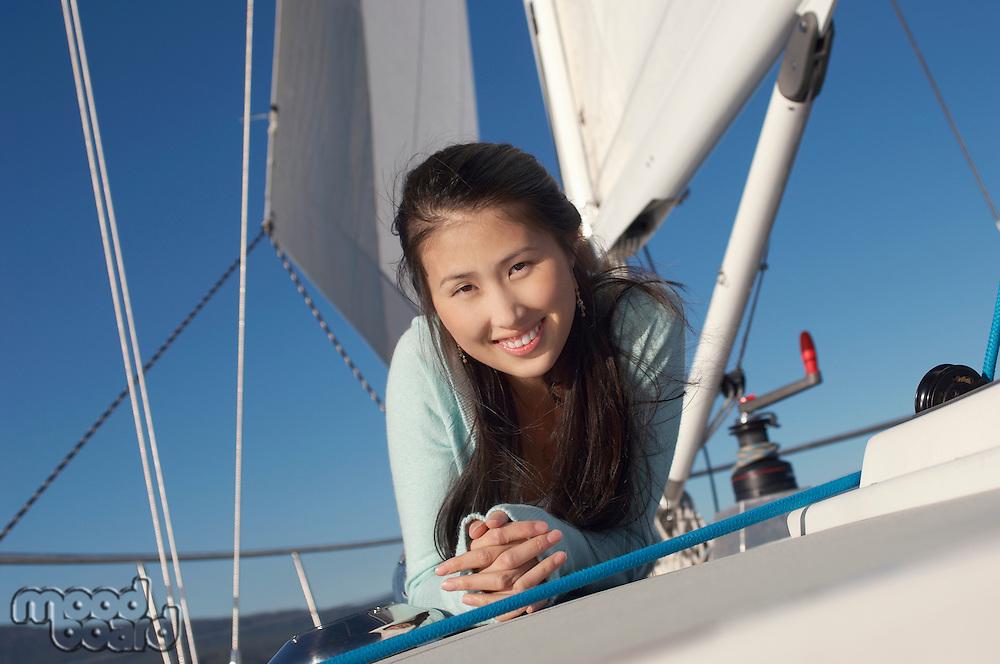 Woman Lying on Sailboat Deck