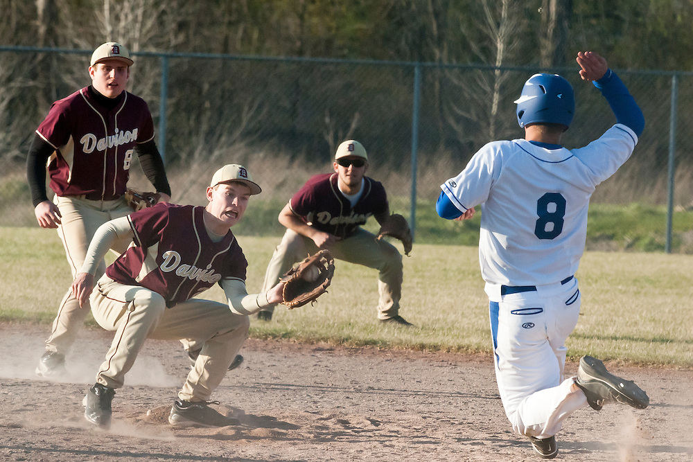 Ben Meinburg of Davison High School prepares to tag out Pete Nagy of Kearsley High School as he slides into second base during a game at Kearsley High School in Genesee Township on Monday, April 9, 2012. Davison defeated Kearsley 9-8.(Lathan Goumas | MLive.com)