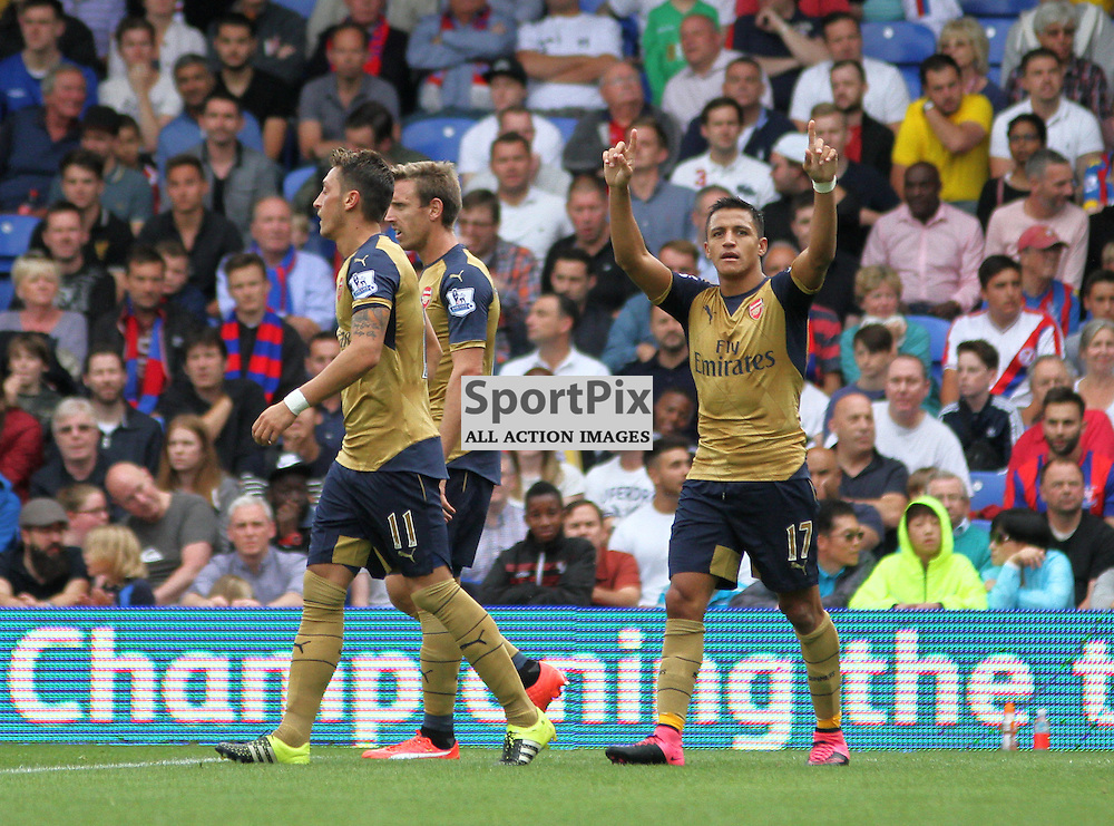 Alexis Sanchez points to the arsenal fans in celebration after scoring During Crystal Palace vs Arsenal on Sunday the 16th August 2015.