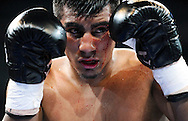 Jorge Silva bleeds from his left eye while boxing against Joshua Clottey during their super welterweight match, Saturday, May 9, 2015, at Minute Maid Park in Houston. Clottey won the match by unanimous decision. (Photo: Eric Christian Smith/For the Chronicle)