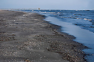 Waves crash on the beach at Grand Isle State Park on March 6, 2011 in Grand Isle, La. The island was heavily impacted by the Deepwater Horizon oil spill April 20, 2010 and continues to recover. The beach has been closed since the oil spill but re-opened in February. (Photo by Carmen K. Sisson/Cloudybright)
