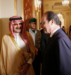 File photo - French President Francois Hollande (R) talks with Saudi business magnate and investor Prince Al-Walid ben Talal ben Abdelaziz Al Saoud before a meeting in Riyadh, Saudi Arabia on Tuesday, May 5, 2015. Hollande is the guest of honor of the 36th Gulf Cooperation Council Summit in Riyadh, where security issues in the region are going to be discussed. A new Saudi anti-corruption body has detained 11 princes, four sitting ministers and dozens of former ministers, media reports say. The detentions came hours after the new committee, headed by Crown Prince Mohammed bin Salman, was formed by royal decree. Among them is Prince Al-Walid ben Talal ben Abdelaziz Al Saoud. Photo by Christophe Ena/Pool/ABACAPRESS.COM  | 499110_007 Riyadh Arabie Saoudite Saudi Arabia