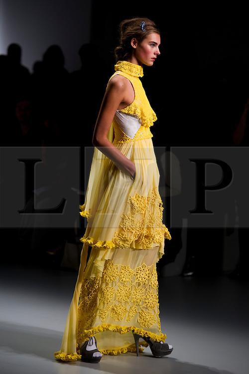 © London News Pictures. 13/09/2013. London, UK.  A model walks the runway at the Bora Aksu show at London Fashion Week Spring/Summer 2014. Photo credit : Ben Cawthra/LNP