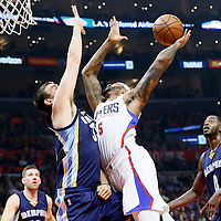 09 November 2015: Los Angeles Clippers forward Josh Smith (5) goes for the layup over Memphis Grizzlies center Marc Gasol (33) during the Los Angeles Clippers 94-92 victory over the Memphis Grizzlies, at the Staples Center, in Los Angeles, California, USA.