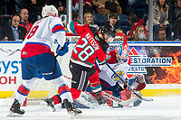 KELOWNA, BC - NOVEMBER 26: Leif Mattson #28 of the Kelowna Rockets tries to put the puck in the net of Sebastian Cossa #33 of the Edmonton Oil Kings during first period at Prospera Place on November 26, 2019 in Kelowna, Canada. (Photo by Marissa Baecker/Shoot the Breeze)