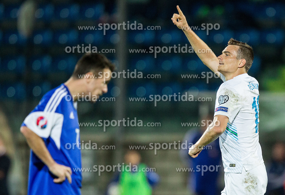 Nejc Pecnik of Slovenia celebrates after scoring second goal for Slovenia during football match between National teams of San Marino and Slovenia in Group E of EURO 2016 Qualifications, on October 12, 2015 in Stadio Olimpico Serravalle, Republic of San Marino. Photo by Vid Ponikvar / Sportida