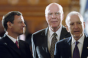 Judge John Roberts (L) talks with Senator James Leahy and Senator Arlen Spector prior to the start of hearings to confirm Roberts as Chief Justice of the Supreme Court 12 September, 2005.   AFP PHOTO/Bob PEARSON