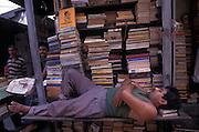 Bookstall keeper takes a nap, Calcutta