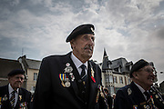 British veterans marching in the streets of Arromanches during the celebration of the 69th anniversary of the D Day