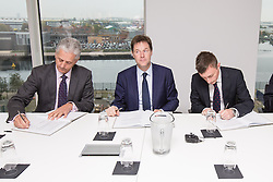 """© Licensed to London News Pictures . 16/10/2014 . Media City, Salford , UK . The Deputy Prime Minister , NICK CLEGG , signs a £467 million """" Greater Manchester Growth Deal """" aimed to drive home building , jobs and increase investment from both public and private sector . Photo credit : Joel Goodman/LNP"""