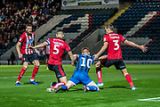 Callum Camps of Rochdale AFC is brought down by Jason Shackell of Lincoln City and /Harry Toffolo of Lincoln City during the EFL Sky Bet League 1 match between Rochdale and Lincoln City at the Crown Oil Arena, Rochdale, England on 17 September 2019.