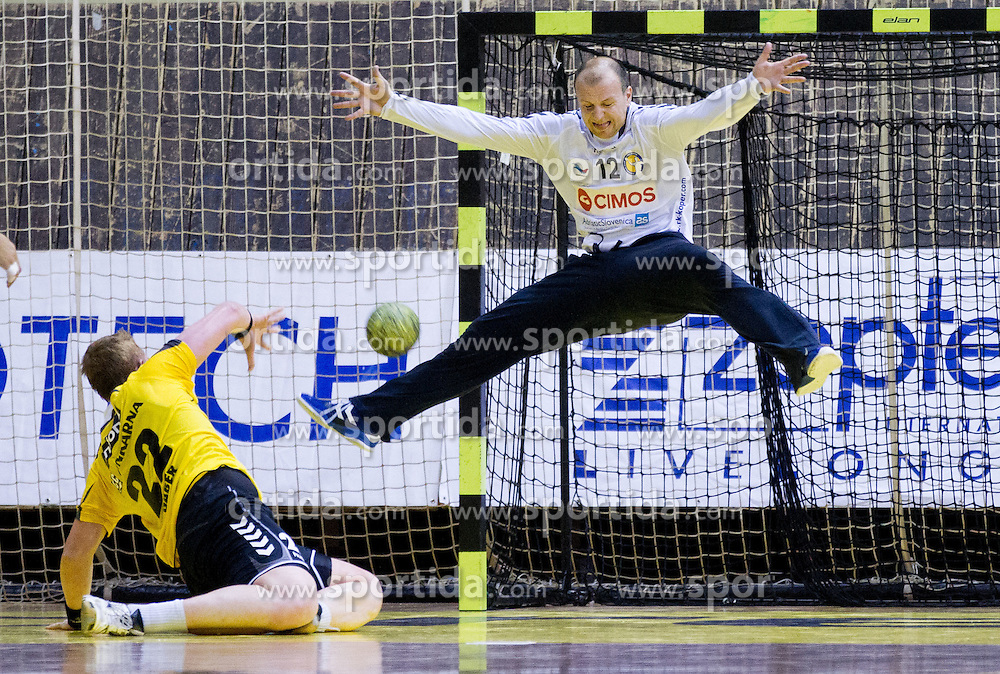 Matej Gaber of Gorenje vs Gorazd Skof of Cimos during handball match between RK Gorenje Velenje vs RK Cimos Koper in 8th Round of 1st NLB Leasing Champions league 2011/12, on May 12, 2012 in Rdeca dvorana, Velenje, Slovenia. Gorenje defeated Cimos Koper 27-25. (Photo by Vid Ponikvar / Sportida.com)