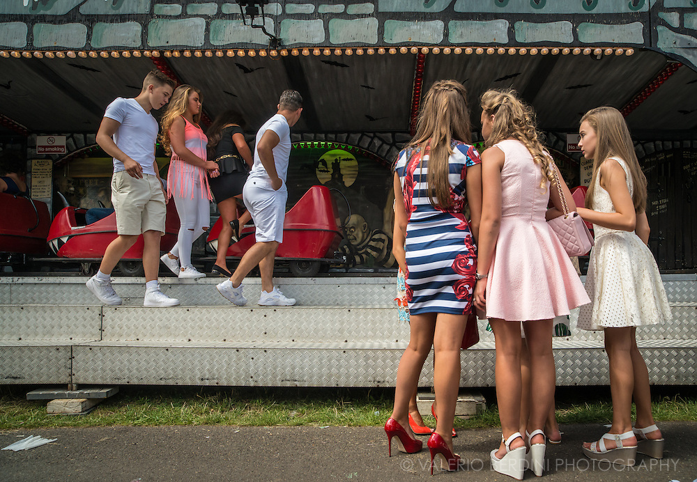 Red shoes. Despite most of the fair is on grass, high heels shoes are one of the essential accessories for girls.