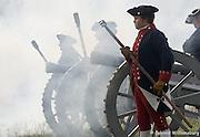 American artillery unit firing cannon.