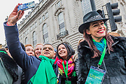 Mayor of London, Sadiq Khan gets another selfie as he leads the London St Patrick's Day parade from Piccadilly to Trafalgar Square.