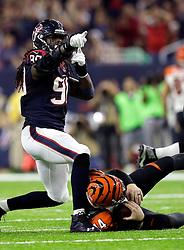 Houston Texans defensive end Jadeveon Clowney (90) celebrates after sacking Cincinnati Bengals quarterback Andy Dalton (14) during the first half of an NFL football game Saturday, Dec. 24, 2016, in Houston. (AP Photo/Sam Craft)