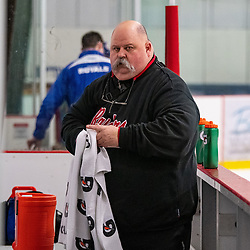 GEORGETOWN, ON - MARCH 2: Andrew Groombridge Head Athletic Trainer of the Georgetown Raiders cleans up the player's bench March 2, 2019 at Gordon Alcott Memorial Arena in Georgetown, Ontario, Canada.<br /> (Photo by Dave Fryer / OJHL Images)