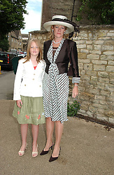 The DUCHESS OF WESTMINSTER and her daughter LADY VIOLA GROSVENOR at the wedding of Hugh van Cutsem to Rose Astor in Burford, Oxfordshire on 4th June 2005.<br />