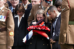© Licensed to London News Pictures. 19/04/2012. DIDCOT, UK. Mourners during the funeral of  Lance Corporal Michael Foley, Adjutant General's Corps (Staff and Personnel Support). He was shot dead by an Afghan soldier on March 26. He is survived by his wife Sophie (pictured centre) and their three young sons who did not attend the service. Photo credit :  Cliff Hide/LNP