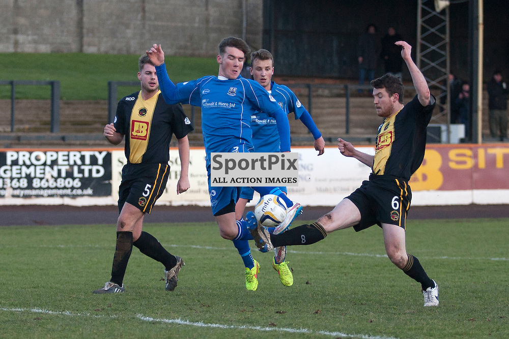 Darryl McHardy (3) puts an early shot over the bar, closely attended by Berwick&rsquo;s Jonny Fairbairn (6) in the Berwick Rangers v Elgin City league match at Shielfield Park, Berwick. 31 January 2014<br />