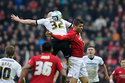 Derby Forward Conor Sammon (IRL) and Nottingham Forest Defender Elliott Ward (ENG) compete in the air during the second half of the match - Photo mandatory by-line: Rogan Thomson/JMP - Tel: Mobile: 07966 386802 19/01/2013 - SPORT - FOOTBALL - Pride Park - Derby. Derby County v Nottingham Forest - npower Championship. The meeting of these two local sides is known as the East Midlands Derby with the winner claiming the Brian Clough Trophy.