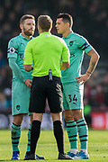Craig Pawson (Referee) talking with Granit Xhaka (Capt) (Arsenal) during the Premier League match between Bournemouth and Arsenal at the Vitality Stadium, Bournemouth, England on 25 November 2018.