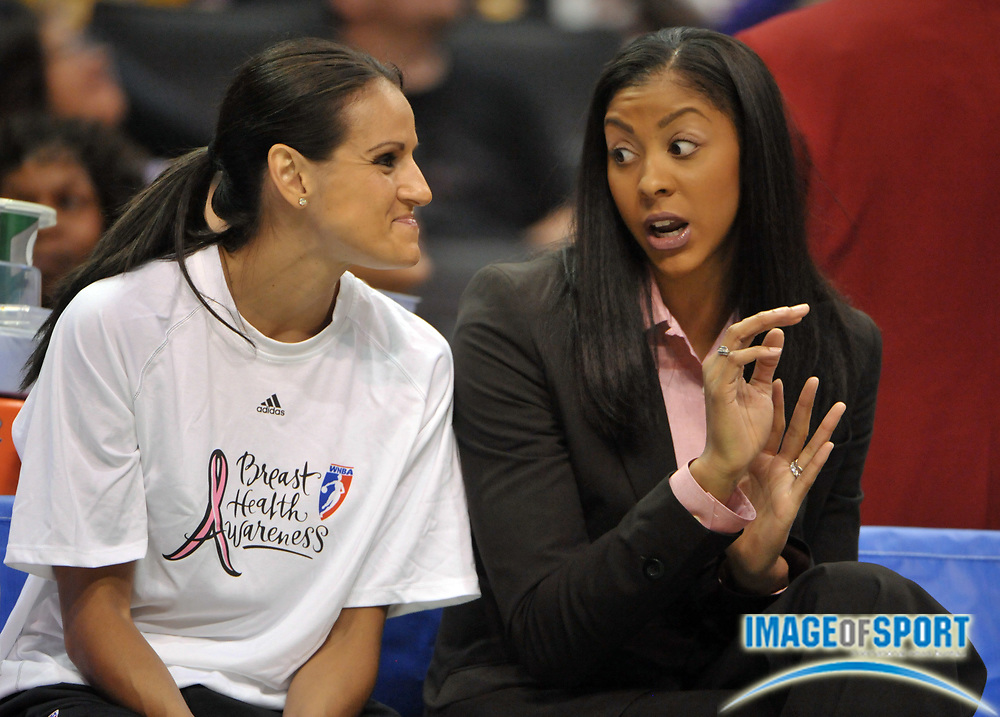 Aug 10, 2010; Los Angeles, CA, USA; Candace Parker (right) talks with Los Angeles Sparks guard Ticha Penicheiro during the game against the Indiana Fever at the Staples Center. The Fever defeated the Sparks 82-76. Photo by Image of Sport