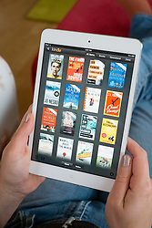 Using Amazon Kindle ebook library on an iPad mini tablet computer