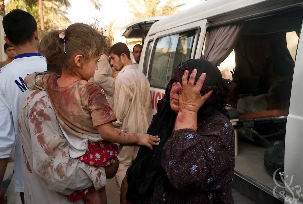 Wounded Iraqi's look out from a city ambulance during a medical evacuation in the Mufrek neighborhood of Bacouba, Iraq June 20, 2007. The Iraqis were injured collaterally during fighting between U.S. forces and Al Qaeda fighters throughout the western part of the city. About 10 Iraqis in the ambulance  begged for U.S. forces to take them to a nearby U.S. military hospital rather than the Bacouba city hospital because of fears that they would be killed by Shia militiamen there.