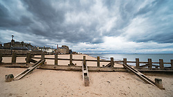 Portobello town and empty beach with wooden groyne on Portobello beach during coronavirus lockdown , Scotland, UK