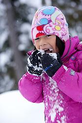 North America, United States, Washington, Crystal Mountain, girl eating snow MR