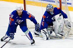 Greg Kuznik (#18) and Robert Kristan (#33) of Slovenia during ice-hockey match between Slovenia and Norway in European Ice Hockey Challenge, on December 17, 2010 at Podmezaklja hall, Ljubljana, Slovenia. (Photo By Matic Klansek Velej / Sportida.com)