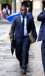 © London News Pictures. 01/10/2012. London, UK . Former UBS trader Kweku Adoboli arriving at Southwark Crown Court in London on October 1, 2012 where he is charged with charged with fraud by abuse of position and false accounting.  Adoboli is accused of undertaking unauthorised trading at Swiss bank UBS that resulted in a $2bn loss for the bank, one of the biggest ever cases of alleged unauthorised trading. Photo credit: Ben Cawthra/LNP