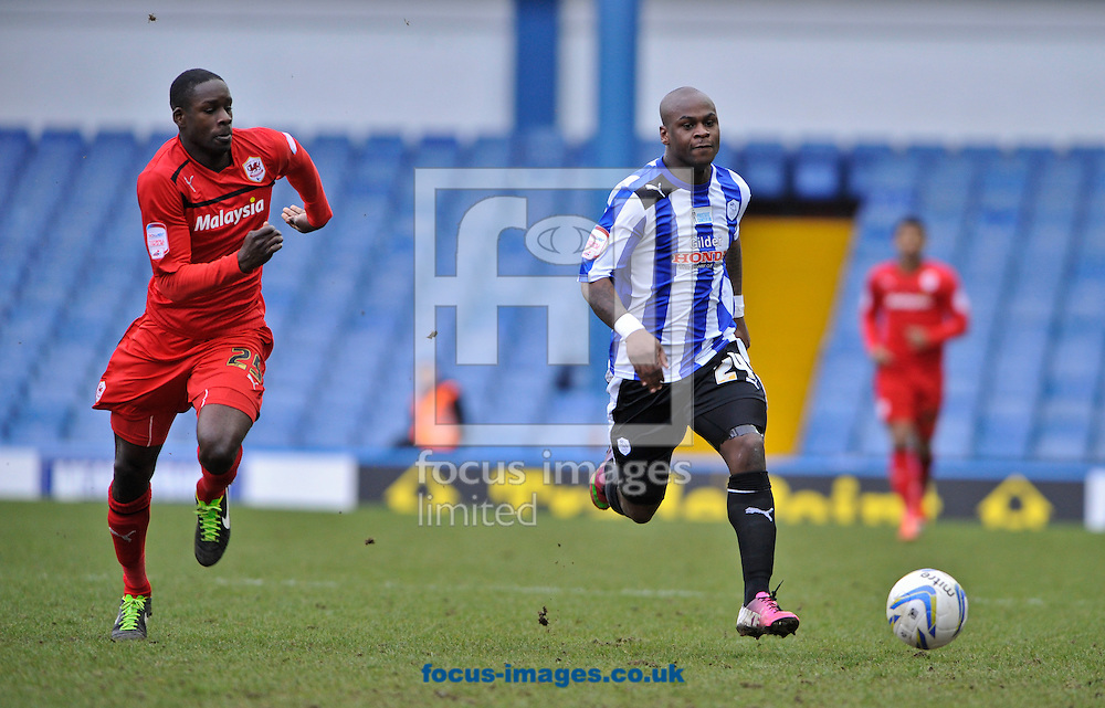 Picture by Richard Land/Focus Images Ltd +44 7713 507003.16/03/2013.Leroy Lita of Sheffield Wednesday and Leon Barnett of Cardiff City during the npower Championship match at Hillsborough, Sheffield.