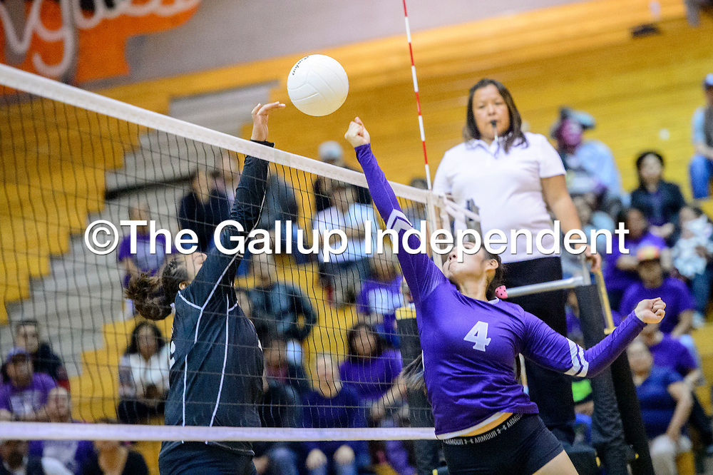 Gallup Bengal Hailey Long (16), left, and  Miyamura Patriot Tia Washburn (4) vie for a ball above the net at Gallup High School Tuesday.
