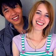 Happy smiling interracial or mixed race college age couple Caucasian female and Asian (Chinese) male