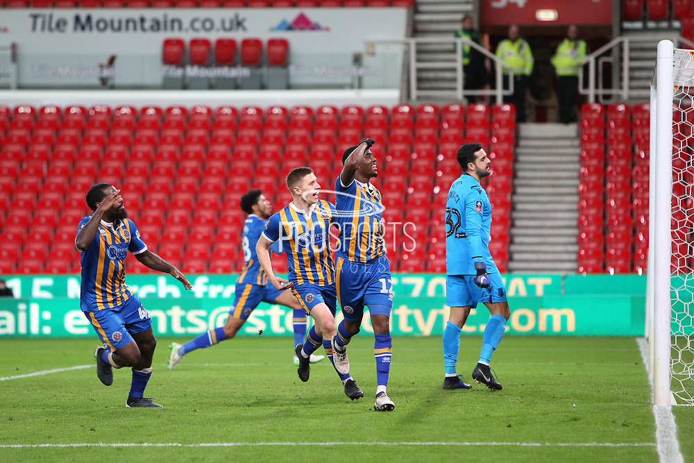 12 Fejeri Okenabirhie celebrates the equaliser during the The FA Cup 3rd round replay match between Stoke City and Shrewsbury Town at the Bet365 Stadium, Stoke-on-Trent, England on 15 January 2019.