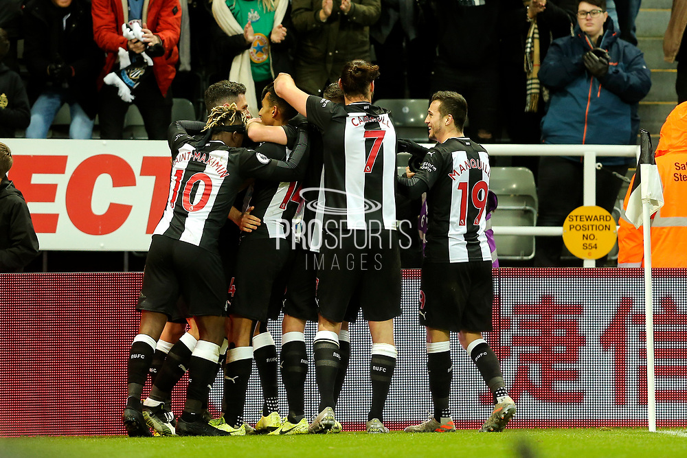 Newcastle United players celebrate Newcastle United's second goal (2-0) scored by Federico Fernandez (#18) of Newcastle United during the Premier League match between Newcastle United and Southampton at St. James's Park, Newcastle, England on 8 December 2019.