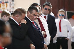 © Licensed to London News Pictures. 21/04/2018. Cobham, UK. Paddy Doherty (c)  at the funeral of his mother Queenie, Elizabeth Doherty at Sacred Heart Church in Cobham, Surrey. Elizabeth Doherty, whose son Paddy Doherty is known for appearing on My Big Fat Gypsy Wedding and winning Celebrity Big Brother 8, died of a heart attack earlier this month. Paddy Doherty claimed his mother has died of a 'broken heart' following the death of her husband almost a year ago. Photo credit: Peter Macdiarmid/LNP