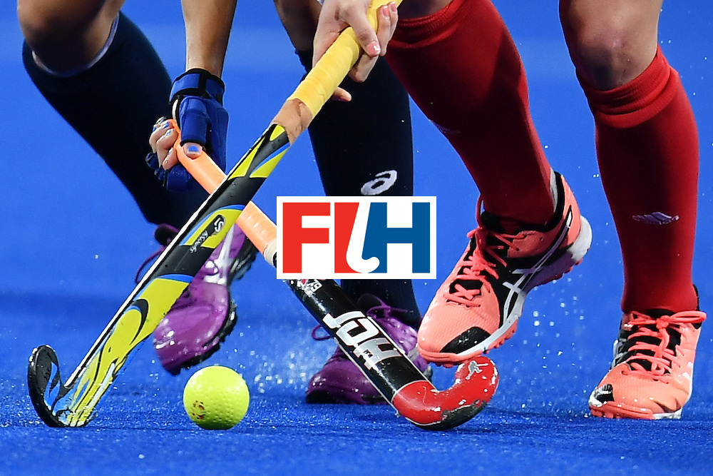 USA's Melissa Gonzalez (L) and Britain's Hannah Macleod vie during the women's field hockey Britain vs the USA match of the Rio 2016 Olympics Games at the Olympic Hockey Centre in Rio de Janeiro on August, 13 2016. / AFP / MANAN VATSYAYANA        (Photo credit should read MANAN VATSYAYANA/AFP/Getty Images)