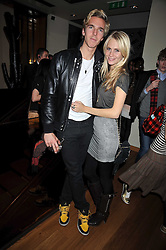 POPPY DELEVIGNE and JAMES COOK at a party hosted by Mulberry to celebrate the Autumn Winter 2009 Collection held at Mulberry, 41/42 New Bond Street, London on 23rd February 2009.