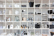 Monochrome shelf display of black and white gifts souvenirs baskets storage vases in shop, Arken Museum of Modern Art, Denmark