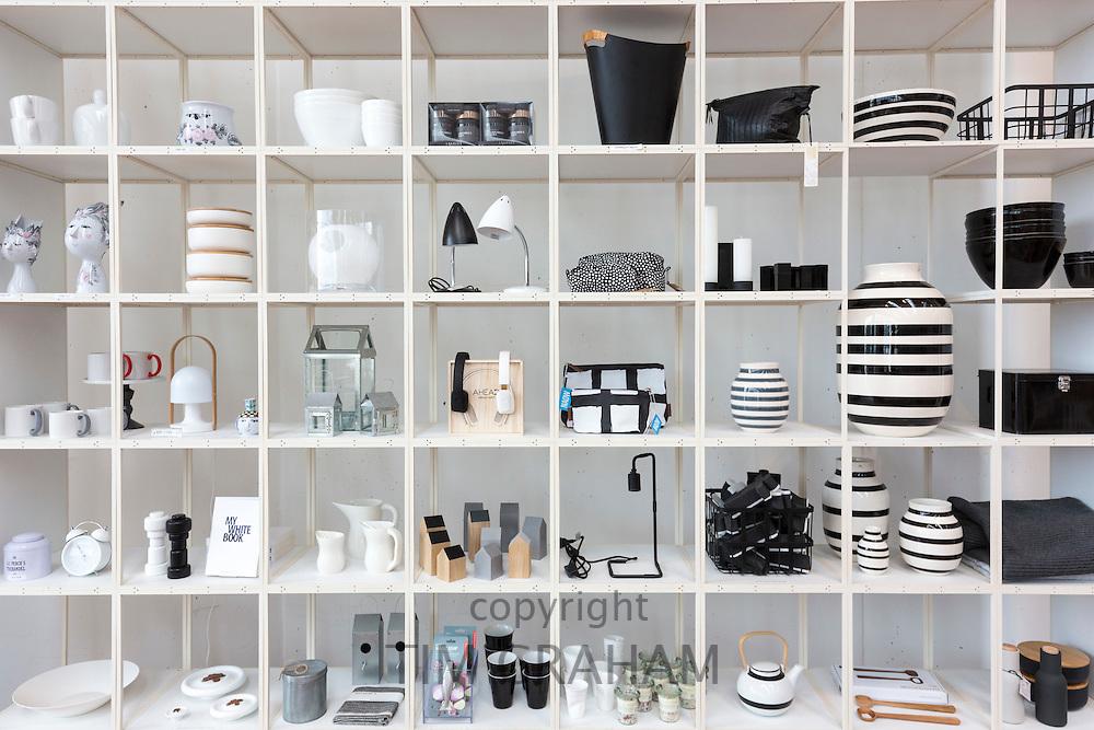 Monochrome shelf display of black and white gifts souvenirs baskets storage vases in shop, Arken Museum of Modern Art, Denmark