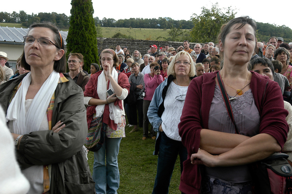 Supporters listen to His Holiness the Dalai Lama addressing the public from the stupa at the Vajradhara Ling Buddhist Temple in Normandie during his His Holiness' visit to France. The Dalai Lama blessed a project to build a Temple for Peace at the center and gave a speech to hundreds of guests...Aubry-le-Panthou, France. 14/08/2008..Photo © J.B. Russell
