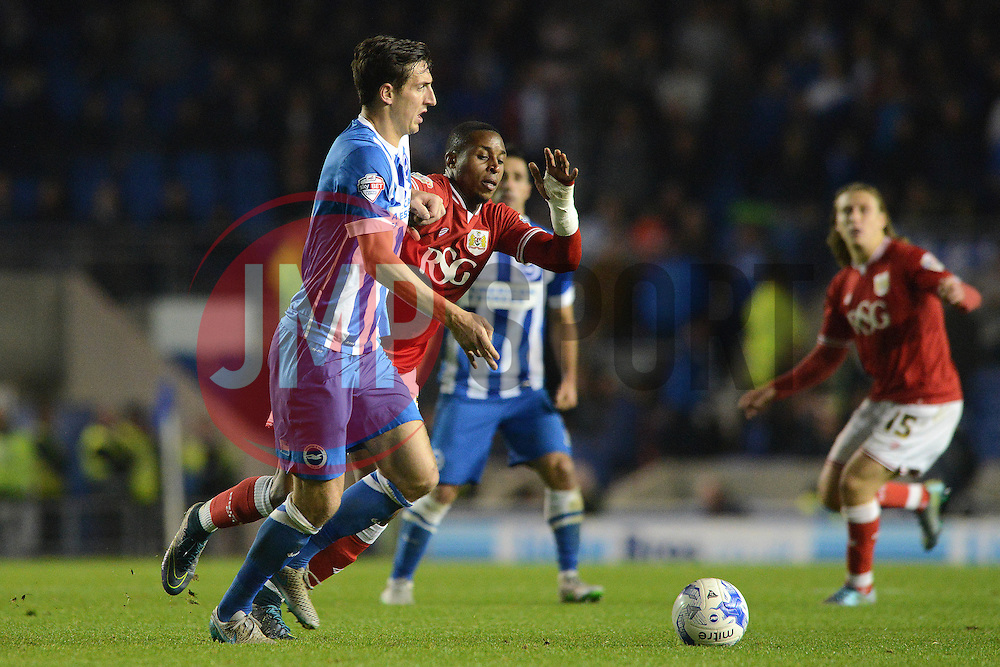 Jonathan Kodjia of Bristol City is challenged by Lewis Dunk of Brighton & Hove Albion - Mandatory byline: Dougie Allward/JMP - 07966 386802 - 20/10/2015 - FOOTBALL - American Express Community Stadium - Brighton, England - Brighton v Bristol City - Sky Bet Championship